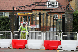 © Licensed to London News Pictures. 29/08/2020. London, UK. A workman installs barriers for social distancing at the entrance of Chestnuts Primary School in Tottenham, north London, as the school prepares for reopening next week, at the start of the new academic year. The council and the school are putting in place measures for social distancing and safe conditions following the coronavirus pandemic. Photo credit: Dinendra Haria/LNP
