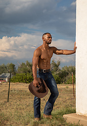 hot shirtless muscular cowboy on a ranch hot cowboy with open shirt on a ranch