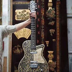Paris, France. Atelier Midavaine. December 12, 2014. A guitar coated with Calais Lace (Dentelle de Calais) and Mongolian Gold by Jean Noël Turquet who also works at the Atelier Midavaine. Photo: Antoine Doyen for The Wall Street Journal - GURU