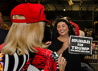 """Mary Ann Logsdon of Laconia shows off her """"Deplorables for Trump"""" sign to Ruthie Reingold at Laconia Middle School Thursday evening.  (Karen Bobotas/for the Laconia Daily Sun)"""