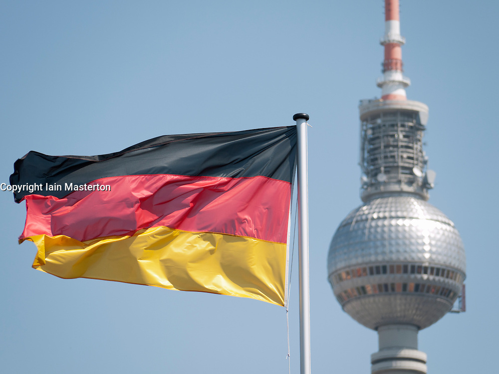 Close-up of German flag and Fernsehturm or Television tower in Berlin Germany