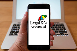 Using iPhone smartphone to display logo of Legal and General the British multinational financial services company