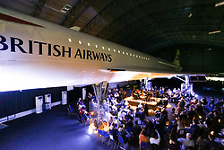 © Licensed to London News Pictures. 11/09/2021. Manchester, UK.  Classical music fans attend a candlelit concert underneath the wings of Concorde at The Concorde Conference Centre in Manchester. One of only 18 left in the world, British Airways Concorde G-BOAC is housed within a purpose built hangar and provides the backdrop for events, conferences and exhibitions at the Runway Visitor Park. Photo credit: Adam Vaughan/LNP