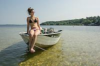 Young woman on Lake Winnisquam.  ©2017 Karen Bobotas Photographer