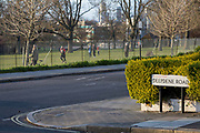 At the beginning of the second week of the UKs Coronavirus lockdown and in accordance with government guidelines for social distancing, family group isolation but local daily exercise, south Londoners practice sensible social distancing while enjoying late sunlight within the railings of Ruskin Park, a green public space in the borough of Lambeth, on 30th March 2020, in south London, England.