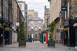 Edinburgh, Scotland, UK. 1 May 2020. Views of Edinburgh as coronavirus lockdown continues in Scotland. Streets remain deserted and shops and restaurants closed and many boarded up. Pictured; Rose Street is very quiet with most shops closed. Iain Masterton/Alamy Live News