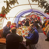 Clients and staff at Adventure Network's Patriot Hills expediton base gather for dinner in the main dining tent, which is decorated for Christmas.