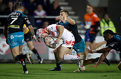 St Helens Saints' Theo Fages goes over for a try past Leeds Rhinos Richie Myler (left), during the Betfred Super League match at the Totally Wicked Stadium, St Helens.