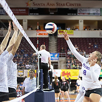 Miyamura's Brooklyn King (8) goes up for a spike in their match against Santa Teresa Thursday morning at the Santa Ana Star Center in the NMAA Class 4A State Volleyball tournament in Rio Rancho.