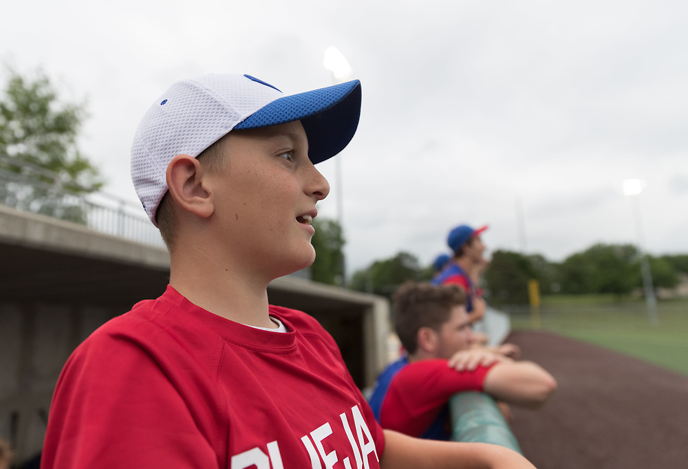 Grayson Gilbert, 11, watches the game. Post 1 Omaha, Nebraska, played Post 307 Renner, South Dakota, in a legion baseball game at Creighton Prep on Wednesday, June 20, 2018, in Omaha, Nebraska.