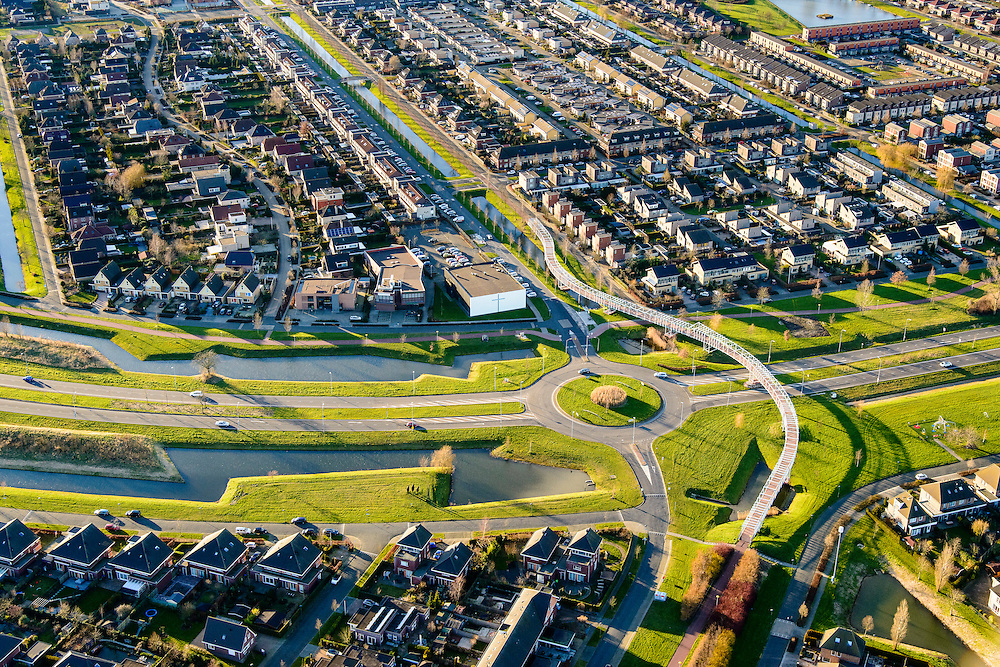 Nederland, Flevoland, Lelystad, 28-02-2016; woonwijk De Landerijen met fietsbrug.<br /> Residential area in new polder.<br /> <br /> luchtfoto (toeslag op standard tarieven);<br /> aerial photo (additional fee required);<br /> copyright foto/photo Siebe Swart