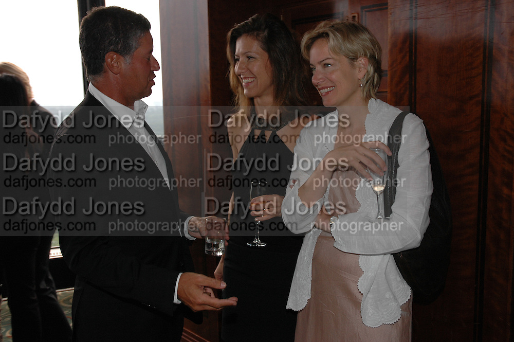 Peter Soros and Michelle Lavery, Telegraph magazine 40th anniversary, Windows, London Hilton. 6 September 2004. SUPPLIED FOR ONE-TIME USE ONLY-DO NOT ARCHIVE. © Copyright Photograph by Dafydd Jones 66 Stockwell Park Rd. London SW9 0DA Tel 020 7733 0108 www.dafjones.com