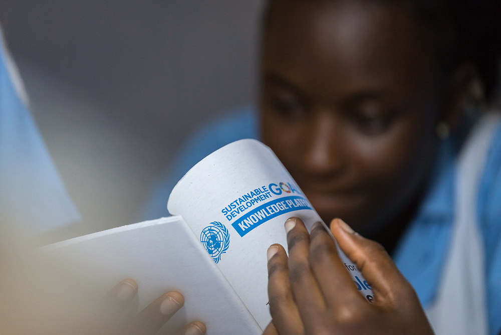 2 November 2019, Ganta, Liberia: A female nurse at Ganta United Methodist Church reads about the Sustainable Development Goals. Located in Nimba county, the Ganta United Methodist Hospital serves tens of thousands of patients each year. It is a founding member of the Christian Health Association of Liberia.