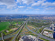 Nederland, Noord-Holland, Amsterdam; 17-04-2021; Knooppunt Amstel, Ring A10 en A2 (naar links richting Utrecht).  <br /> Rechts van de A10 bij rivier de Amstel volktuinencomplex Amstelglorie. Hoogbouw van de Zuidas in het verschiet met daar achter de Nieuwe Meer.<br /> Amstel junction, Ring A10 and A2 (to the left towards Utrecht). Next to ringroad  A10 near the river Amstel allotment garden complex Amstelglorie. High-rise buildings of the Zuidas in the distance with the Nieuwe Meer behind it.<br /> luchtfoto (toeslag op standard tarieven);<br /> aerial photo (additional fee required)<br /> copyright © 2021 foto/photo Siebe Swart