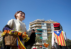 Giants and flags fill the streets in the centre of Barcelona while tens of thousands of Catalans separatists march in protest during 'La Diada', the annual festival to mark National Day of Catalonia, demanding the independence of Catalonia.