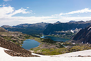 The Wind River Range, mountains in the Shoshone National Forest, Fremont County, Wyoming, USA. Macon Lake on the left, Washakie Lake on the right and further away, from the east side of Washakie Pass.
