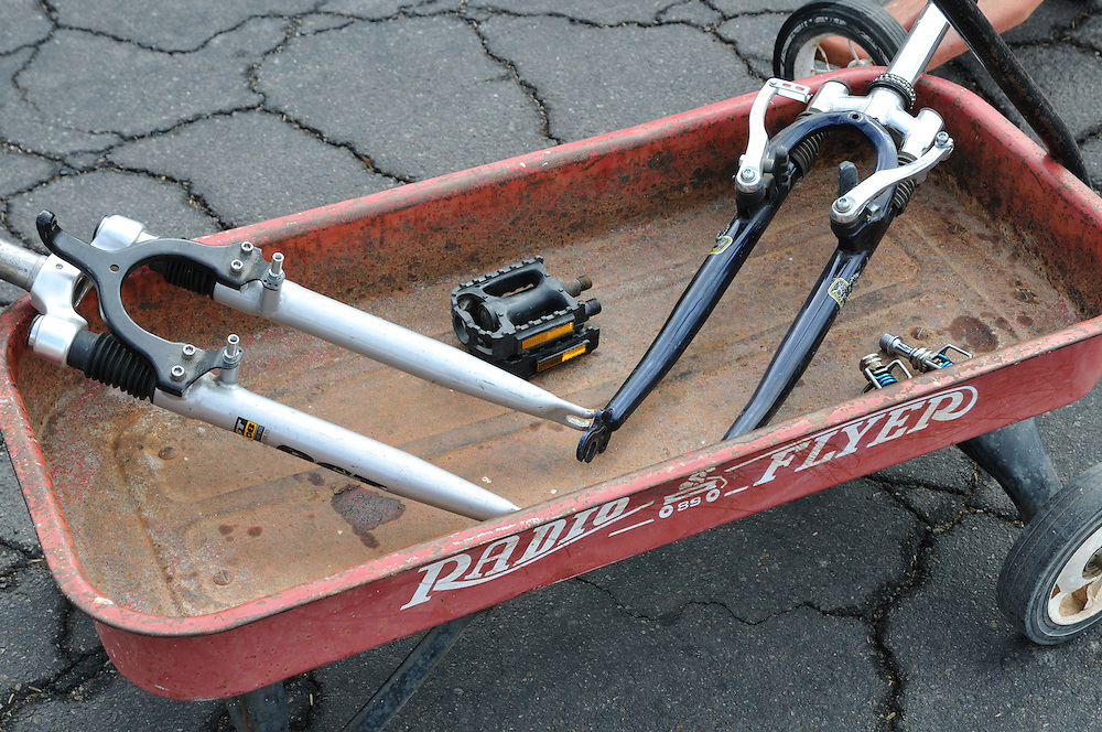 Pedals and suspension forks for sale. No word on the little red wagon's sale status. Bike-tography by Martha Retallick.