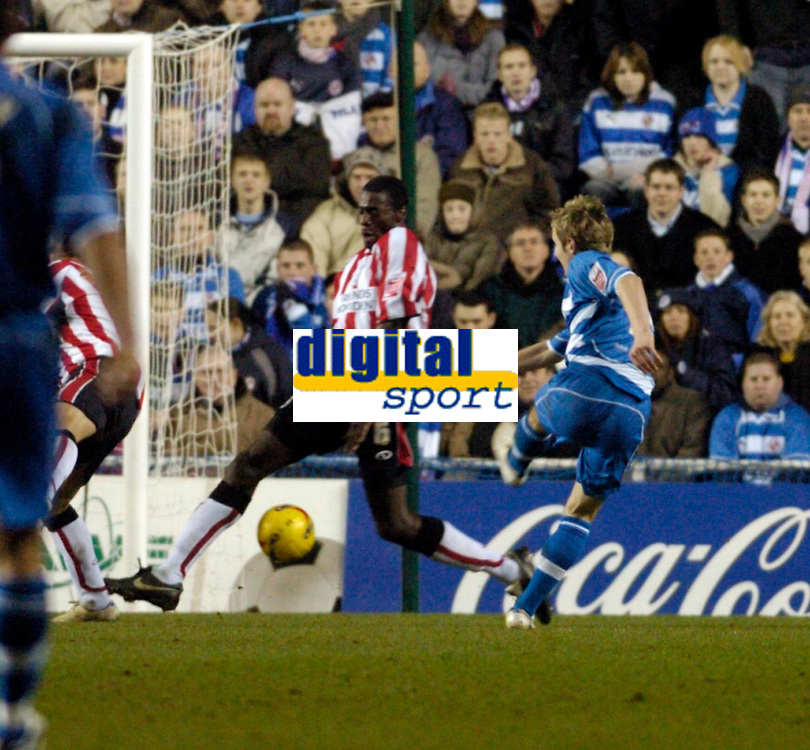 Photo: Leigh Quinnell.<br /> Reading v Southampton. Coca Cola Championship. 10/02/2006. Readings Kevin Doyle shoots through the legs of Southamptons Darren Powell to score.