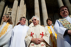© licensed to London News Pictures. London, UK 03/05/2014. More than 500 women priests who ordained in 1994 gathering outside St Paul's Cathedral ahead of a celebratory service to mark the twentieth anniversary of women becoming ordained priests in the Church of England. Photo credit: Tolga Akmen/LNP