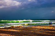 Fine Art: Hurricane off the east coast of Deerfield Beach, Florida. The sun comes through to light up the beach and waves before they crash into the sand.