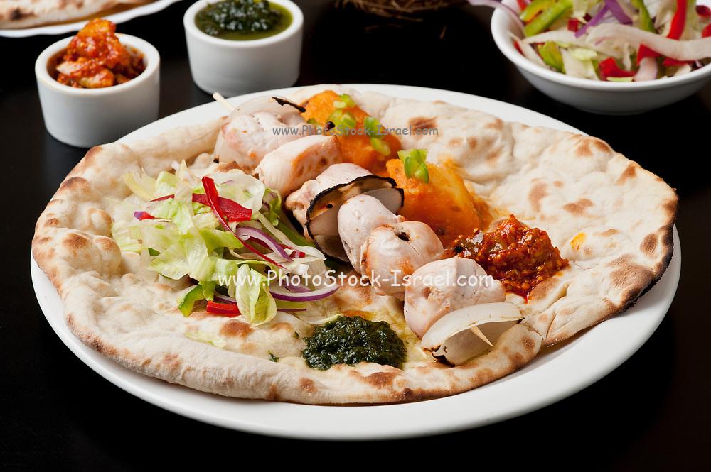 Indian Ethnical Food Chicken tikka masala on Naan Bread