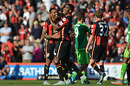 AFC Bournemouth's defender Sylvain Distin and AFC Bournemouth's striker Callum Wilson celebrate the win during the Barclays Premier League match between Bournemouth and Sunderland at the Goldsands Stadium, Bournemouth, England on 19 September 2015. Photo by Mark Davies.