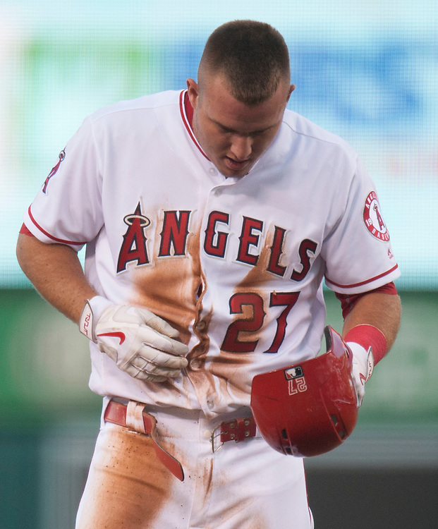 The Angels' Mike Trout checks out his belt after getting thrown out stealing to end the first inning against the Oakland Athletics at Angel Stadium on Tuesday.<br /> <br /> ///ADDITIONAL INFO:   <br /> <br /> angels.0803.kjs  ---  Photo by KEVIN SULLIVAN / Orange County Register  -- 8/2/16<br /> <br /> The Los Angeles Angels take on the Oakland Athletics at Angel Stadium.