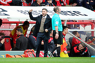 Bristol City manager, Lee Johnson celebrating Bristol City striker, Lee Tomlin (9) scoring 0-1 during the Sky Bet Championship match between Brentford and Bristol City at Griffin Park, London, England on 16 April 2016. Photo by Matthew Redman.