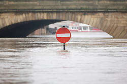 © Licensed to London News Pictures. 07/12/2015. York UK. York has flooded for the second time this month after the river Ouse burst it banks last night with the after effects of Storm Desmond. Photo credit: Andrew McCaren/LNP