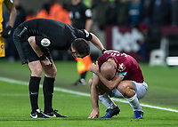 Football - 2018 / 2019 Premier League - West Ham United vs. Brighton & Hove Albion<br /> <br /> Referee Christopher Kavanagh checks on Pablo Zabaleta (West Ham United) at the London Stadium<br /> <br /> COLORSPORT/DANIEL BEARHAM
