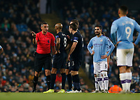 Football - 2019 / 2020 Premier League - Manchester City vs. Everton<br /> <br /> Referee Andre Marriner talks to the players after VAR looks at a possible penalty call in favour of Manchester City, at The Etihad Stadium.<br /> <br /> COLORSPORT/ALAN MARTIN