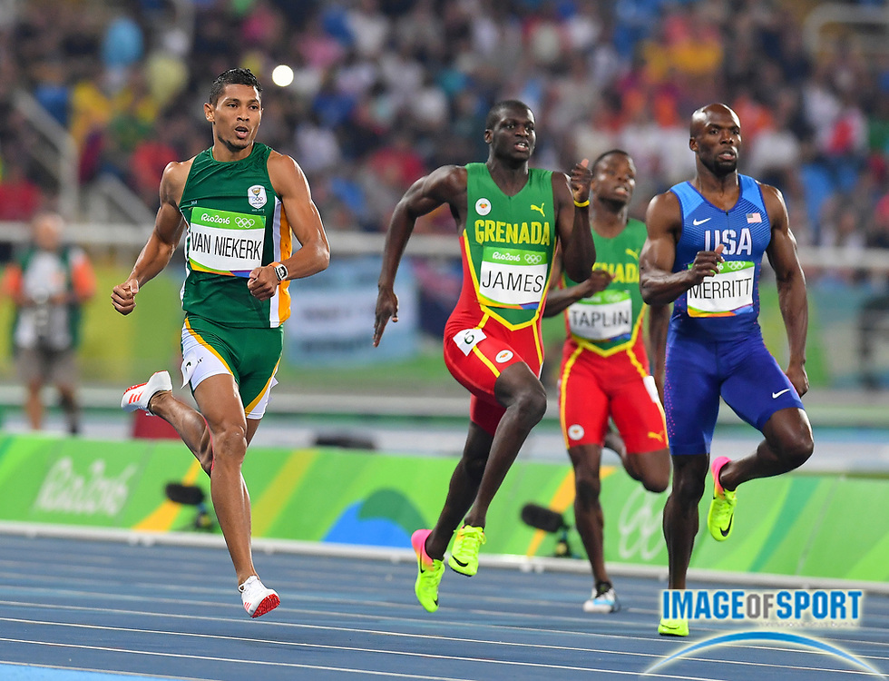 Wayde van Niekerk (RSA) sets a world record of 43.03 in the 400m in the athletics competitions of the 2016 Summer Olympics at the Olympic stadium in Rio de Janeiro, Brazil, Sunday, Aug. 14, 2016. Photo by Roger Sedres