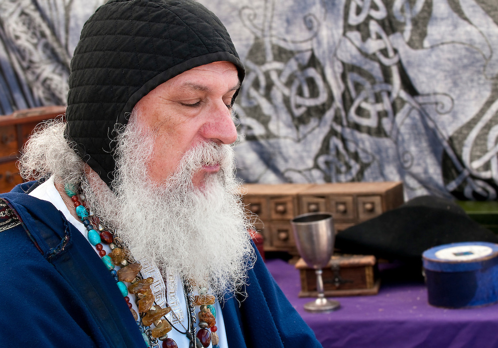Old man, fortune teller meditating in his tent.