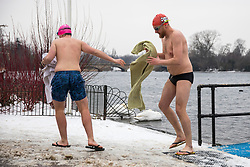 © Licensed to London News Pictures. 02/03/2018. London, UK. Members of the Serpentine Swimming Club dash to the changing rooms after braving -1°C water temperatures in the Serpentine in Hyde Park. The 'Beast from the East' and Storm Emma have brought extreme cold, ice and heavy snow to the UK. Photo credit: Rob Pinney/LNP