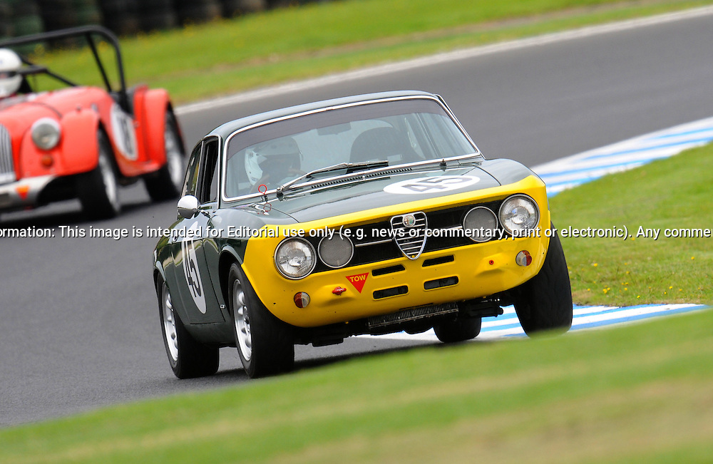 Tony Norris - Alfa Romeo 105.Historic Motorsport Racing - Phillip Island Classic.18th March 2011.Phillip Island Racetrack, Phillip Island, Victoria.(C) Joel Strickland Photographics.Use information: This image is intended for Editorial use only (e.g. news or commentary, print or electronic). Any commercial or promotional use requires additional clearance.