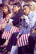"""04 JULY 2009 -- PHOENIX, AZ:  A new US citizen rests on his cane at a naturalization ceremony in Phoenix, AZ, July 4. U.S. Citizenship and Immigration Services and South Mountain Community College in Phoenix, AZ, hosted the 21st annual """"Fiesta of Independence"""" Saturday, July 4. More than 180 people from 58 countries took the US Oath of Citizenship and became naturalized US citizens. The ceremony was one of dozens of similar ceremonies held across the US this week. USCIS said more than 6,000 people were naturalized US citizens during the week.  Photo by Jack Kurtz / ZUMA Press"""
