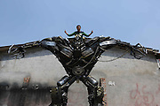TIANJIN, CHINA - APRIL 20: (CHINA OUT) <br /> <br /> Home-made Transformers<br /> <br /> Thirty-five-year-old Lu Peng poses with his home-made Transformers  on April 20, 2015 in Tianjin, China. Lu Peng fell in love with Transformers in 2012 when he finished the first 4.25-meter-high Optimus Prime with the help of father. With a Machinery Dream, he quitted his job in 2014 and began his Transformers road. <br /> ©Exclusivepix Media