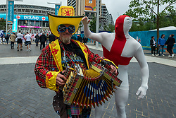 © Licensed to London News Pictures. 18/06/2021. LONDON, UK.  Football fans arrive for the Euro 2020 Group D match between England and Scotland match at Wembley Stadium. The tournament was postponed from 2020 due to the COVID-19 pandemic in Europe and rescheduled for 11 June to 11 July 2021 with matches to be played in 11 cities. Wembley Stadium will host certain group matches, as well as the semi-finals and final itself.  Photo credit: Stephen Chung/LNP