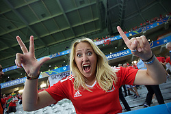 LILLE, FRANCE - Friday, July 1, 2016: A Wales supporter celebrates the 3-1 victory over Belgium at full time after the UEFA Euro 2016 Championship Quarter-Final match at the Stade Pierre Mauroy. (Pic by Paul Greenwood/Propaganda)