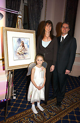 MISS CHLOE LUCAS and her parents MARK & EMILY LUCAS at a reception to launch Angel themed Christmas Cards and view an exhibition of the original art work by Gordon King with proceeds going to the Caron Keating Foundation  held at the Langham Hotel, Portland Place, London on 20th November 2006.<br />