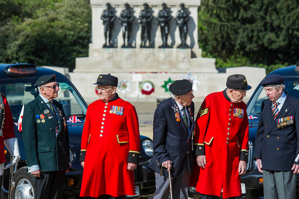 Rick Forest, 89 D-day, Reginald Widerspoon, 90, Charles Jeffries, 93 D-day/Dessert Rat, John Cuthbert, 92, Peter Kent, 90 Royal Navy (L to R) - Second World War Veterans, Reg Wilderspin (89) and John Cuthbert (92), and serving Guardsmen on Horse Guards Parade Ground to highlight Royal British Legion events on Victory in Europe (VE) Day. The Legion is also announcing that veterans and their carers will receive funding towards attending the event on the weekend of the 8-10th May.<br /> <br /> Places will be available for a series of commemorative events over the weekend including on VE Day itself, Friday 8 May, when a Service of Remembrance will be held at The Cenotaph, with a national two minute silence at 3pm. On Sunday 10 May, there will a Service of Thanksgiving at 11am at Westminster Abbey attended by HM The Queen, followed by a parade from the Abbey to Horse Guards Parade and into St James's Park, where the Legion will host a lunch reception for the veterans.