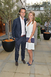 CHARLIE & ANNEKE GILKES at a party to celebrate the launch of Le Jardin de Monsieur Li by Hermes in association with Mr Fogg's was held at Hermes, 155 New Bond Street, London on 9th July 2015.