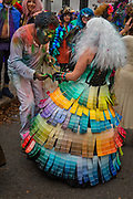 A dress made from Pantone samples in the Society of Saint Anne parade during Mardi Gras on 25th February 2020 in Bywater district of New Orleans, Louisiana, United States. Mardi Gras is the biggest celebration the city of New Orleans hosts every year. The magnificent, costumed, beaded and feathered party is laced with tradition and  having a good time. Celebrations are concentrated for about two weeks before and culminate on Fat Tuesday the day before Ash Wednesday and Lent.