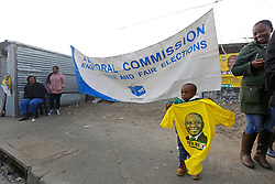 Wednesday 8th May 2019.<br /> Monwabisi Park, Harare,<br /> Khayelitsha, Cape Town, <br /> Western Cape, <br /> South Africa.<br /> <br /> SOUTH AFRICAN GENERAL ELECTIONS 2019!<br /> <br /> SOUTH AFRICAN PROVINCIAL AND NATIONAL ELECTIONS 2019! <br /> <br /> A young boy holds an ANC political party t-shirt as he and family members enjoy the somewhat festive activities on Election Day outside the voting station at Monwabisi Park, Harare in Khayelitsha near Cape Town, Western Cape, South Africa.<br /> <br /> Registered South African Voters head to the various IEC (Independent Electoral Commission) Voting Stations where they are registered to vote as they cast their votes and take part in voting and other activities on Voting Day 8th May 2019 during the South African General Elections 2019. Voters from across the nation stood in queue's along with many others to vote in the Provincial and National Elections being held in South Africa on Wednesday 8th May 2019.   <br />  <br /> Copyright © Mark Wessels. All Rights Reserved. No Usage Without Permission.<br /> <br /> PICTURE: MARK WESSELS. 08/05/2019.<br /> +27 (0)61 547 2729.<br /> mark@sevenbang.com<br /> studioseven@mweb.co.za<br /> www.markwesselsphoto.com