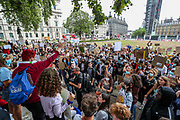 A pupil addresses a mass of peaceful protest in Parliament Square, in Central London on Sunday, Aug 16, 2020 - is continuing in response to the downgrading of A-level results. Thousands of pupils across England have expressed their disappointment at having their results downgraded after exams were cancelled due to coronavirus. A-levels results that were announced on 13 August. Some 40 per cent of students across England have received downgraded results. (VXP Photo/ Vudi Xhymshiti)