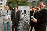 05 OCT 1999, BERLIN/GERMANY:<br /> Kurt Bodewig, MdB, SPD, Michael Roth, MdB, SPD, Hans-Peter Bartels, MdB, SPD, Carsten Schneider, MdB, SPD, und Christian Lange, MdB, SPD, alle Mitherausgeber des Magazins BERLINER REPUBLIK, mit einem Werbeschild der Erstausgabe, nach einer Pressekonferenz, Alexanderplatz<br /> IMAGE: 19991005-01/02-03