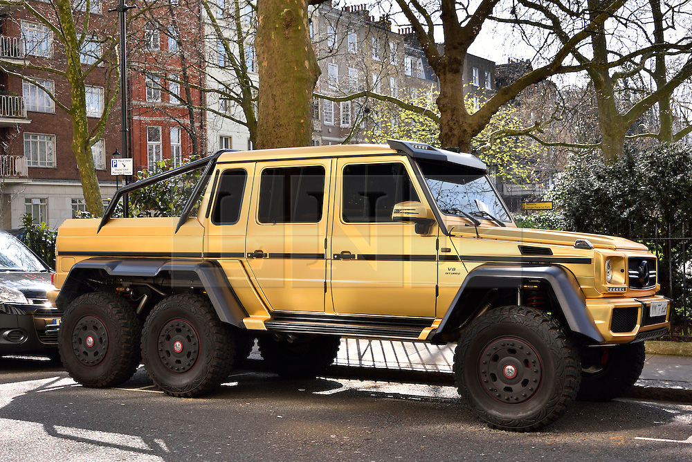 © Licensed to London News Pictures. 31/03/2016. London, UK. A fleet of supercars including a six-wheel £370,000 Mercedes G63 covered in gold chrome wrap is parked in Knightsbridge, London on Wednesday, 31 March 2016. Cars are believed to be owned by Saudi billionaire Turki Bin Abdullah .Photo credit: Ray Tang/LNP