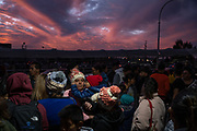 """Migrants part of the """"Remain in Mexico"""" policy wait at the entrance to the Paso del Norte International Bridge on February 28th 2020 in Ciudad Juárez, Mexico. Asylum seekers part of the MPP program, better known as the """"Remain in Mexico"""" policy gathered at bridge in hopes of being allowed across after the United States Court of Appeals for the Ninth Circuit deemed the law invalid, however, the court granted the Trump Administration a stay on the program, for fear of creating an influx on the southern border."""