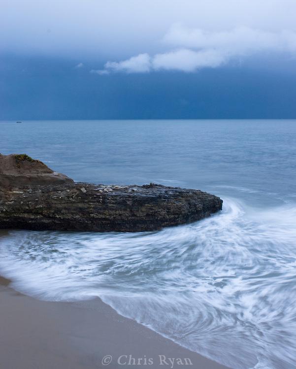 Waves slipping back into Monterey Bay, Santa Cruz, California