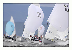 470 Class European Championships Largs - Day 3.Brighter conditions with more wind...Men, downwind, Fleet, CRO83, Sime FANTELA, Igor MARENIC and GRE165, Panagiotis KAMPOURIDIS, Efstathios PAPADOPOULOS, Yaucht Club Of Greece.